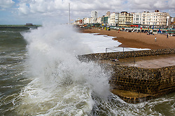 © Licensed to London News Pictures. 28/07/2016. Brighton, UK. A handful of people can be seen relaxing on the beach in Brighton and Hove as strong winds and powerful waves are hitting the seaside resort. Photo credit: Hugo Michiels/LNP