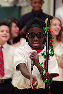 Robbie Mockleads the Singing Chargers as they perform Never Say Never during the 'We Will Jingle!' arts concert at Cleveland PK-8 school in Dayton, Wednesday, December 12, 2012.