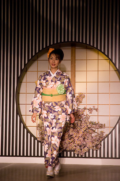 A model starts her catwalk at a kimono fashion show in Kyoto