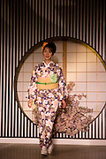 A model starts her catwalk at a kimono fashion show in Kyoto