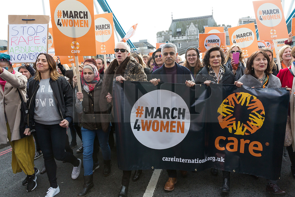 © Licensed to London News Pictures. 05/03/2017. LONDON, UK.  Celebrities join feminist activists to take part in the March4Women as it passes over Tower Bridge, organised by CARE International to mark International Women's Day. The Women's Day March begins at The Scoop near City Hall, before proceeding over Tower Bridge and finishing at the Tower of London. Photo credit: Vickie Flores/LNP