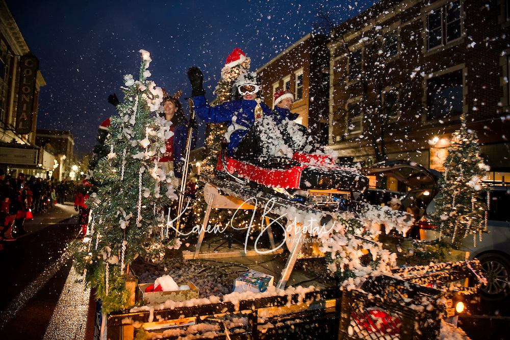 The Gunstock Mountain float brought a snow squall through downtown Laconia during the annual Holiday Parade on Saturday evening.  (Karen Bobotas/for the Laconia Daily Sun)