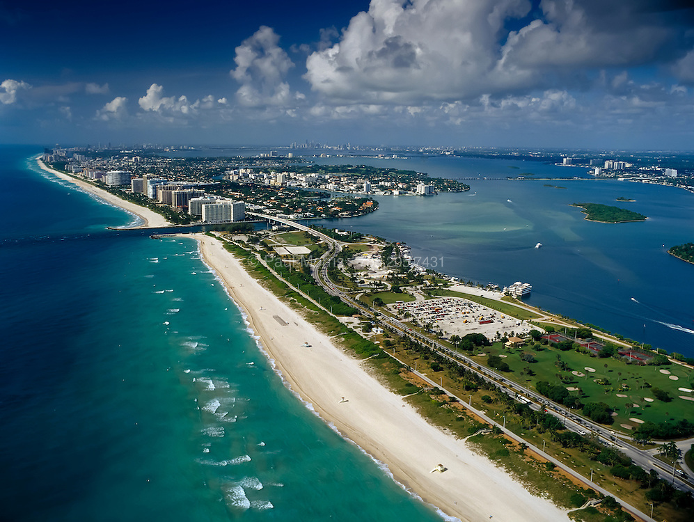 Aerial of Haulover Beach showing Haulover inlet, Biscayne Bay, intracoastal waterway and downtown Miami in the distance.