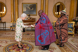 Queen Elizabeth II meets the High Commissioner of Lesotho Dr. John Oliphant and his wife Mrs Oliphant as he presents his Letters of Credence during an audience at Buckingham Palace, London.