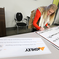 Colby Maxwell, development representative for ALSAC for St. Jude Reasearch Hospital, copies over information for a check for a donation of $31,476.65 from Ashley Furniture Industries in Ecru Friday morning. There was also a $43,300.45 donation made by to Le Bonheur Children's Hospital.