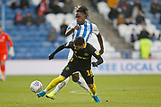 Saïd Benrahma of Brentford  goes pastTrevoh Chalobah of Huddersfield Town during the EFL Sky Bet Championship match between Huddersfield Town and Brentford at the John Smiths Stadium, Huddersfield, England on 18 January 2020.