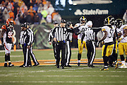 (L-R) NFL field judge Buddy Horton (82), umpire Mark Pellis (131), and referee John Parry (132) try to regain order and clear the field of unnecessary players and coaches after Cincinnati Bengals running back Giovani Bernard (25) gets hit hard by Pittsburgh Steelers inside linebacker Ryan Shazier (50) causing a third quarter fumble, recovered by Shazier, and starting a player melee over no penalty call for unnecessary roughness and leading with the helmet during the NFL AFC Wild Card playoff football game against the Pittsburgh Steelers on Saturday, Jan. 9, 2016 in Cincinnati. The Steelers won the game 18-16. (©Paul Anthony Spinelli)