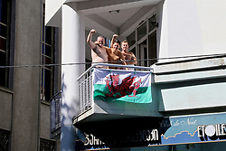TBILSI, GEORGIA - Friday, October 6, 2017: Wales supporters on a hotel balcony in Tbilisi ahead of the 2018 FIFA World Cup Qualifying Group D match between Georgia and Wales. (Pic by David Rawcliffe/Propaganda)