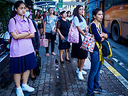 25 SEPTEMBER 2017 - RANGSIT, PATHUM THANI, THAILAND: People wait for buses at a transit station in Rangsit.       PHOTO BY JACK KURTZ