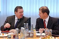 27 JAN 2003, BERLIN/GERMANY:<br /> Gerhard Schroeder (L), SPD, Bundeskanzler, und Olaf Scholz (R), SPD, Generalsekretaer, im Gespraech, vor Beginn   einer Sitzung des SPD Praesidiums, Willy-Brandt-Haus<br /> IMAGE: 20030127-01-017<br /> KEYWORDS: Präsidium, Gerhard Schröder, Gespräch