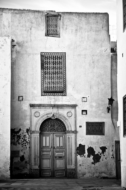 Kairouan, Tunisia 27 October 2011<br /> Street scene in the Medina of Kairouan.<br /> Kairouan is the capital of the Kairouan Governorate in Tunisia. Referred to as the Islamic Cultural Capital, it is a UNESCO World Heritage site. The city was founded by the Arabs around 670. In the period of Caliph Mu'awiya it became an important centre for Islamic and Quranic learning, and thus attracting a large number of Muslims from various parts of the world. The holy Mosque of Uqba is located in the city. It is considered by many Muslims to be Islam's fourth holiest city.<br /> Photo: Ezequiel Scagnetti