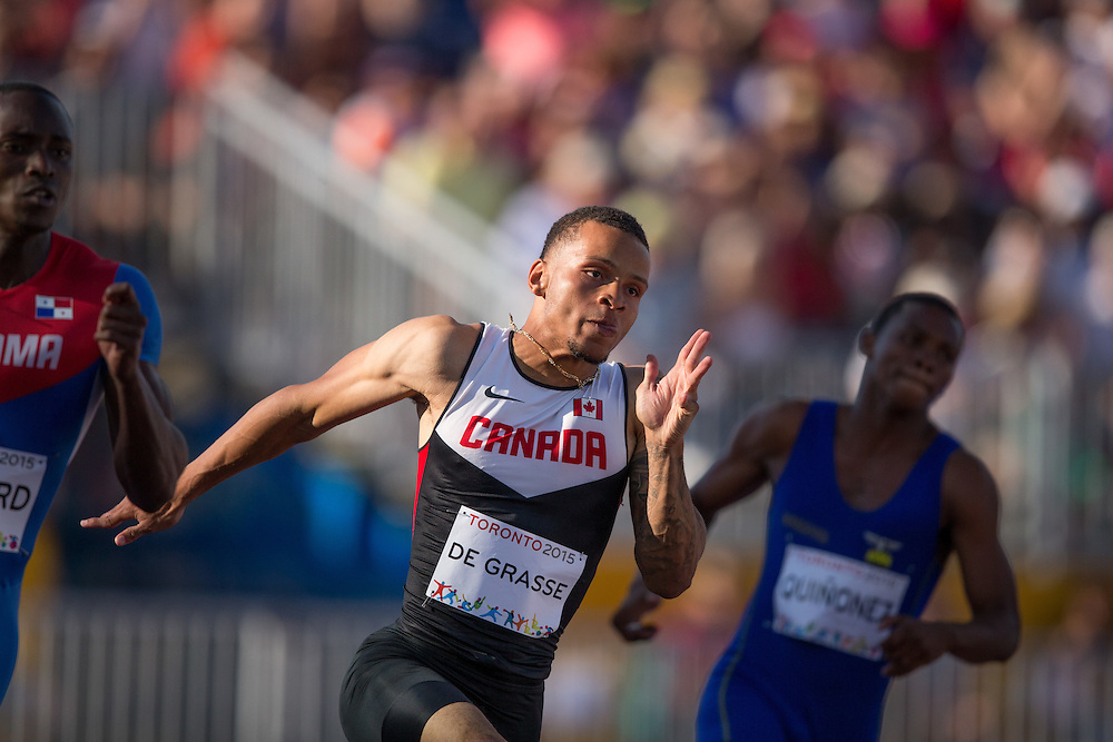 Andre De Grasse of Canada runs in the men's 200 metre heats at the CIBC Athletics Stadium at the at the 2015 Pan American Games in Toronto, Canada, July 23,  2015.  AFP PHOTO/GEOFF ROBINS