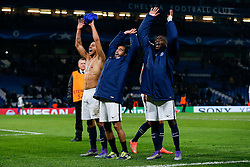 Marquinhos, Lucas and Blaise Matuidi celebrate after Paris Saint-Germain win the math 1-2 to progress to the last 8 of the competition - Mandatory byline: Rogan Thomson/JMP - 09/03/2016 - FOOTBALL - Stamford Bridge Stadium - London, England - Chelsea v Paris Saint-Germain - UEFA Champions League Round of 16: Second Leg.