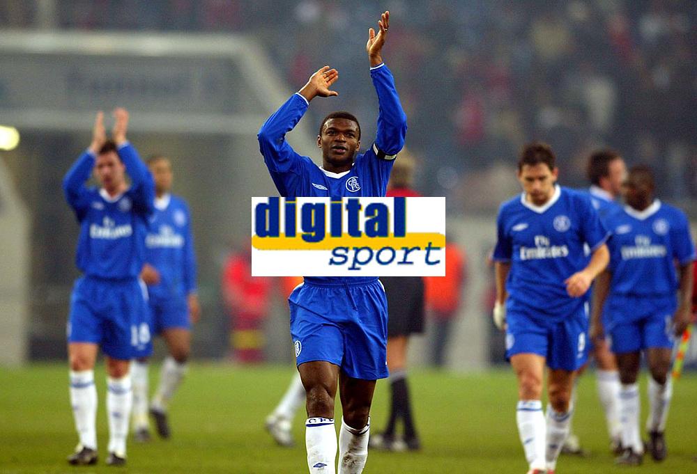 Photograph: Scott Heavey.<br />Besiktas v Chelsea. UEFA Champions league Group G. 09/12/2003.<br />Marcel Desailly applauds the travelling fans