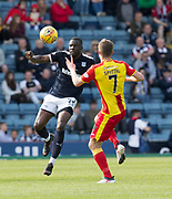 12th May 2018, Dens Park, Dundee, Scotland; Scottish Premier League football, Dundee versus Partick Thistle; Genseric Kusunga of Dundee runs at Blair Spittal of Partick Thistle
