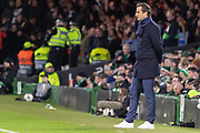 A very casual Rennes Manager Julien Stephan stands in the technical are during the Europa League match between Celtic and Rennes at Celtic Park, Glasgow, Scotland on 28 November 2019.