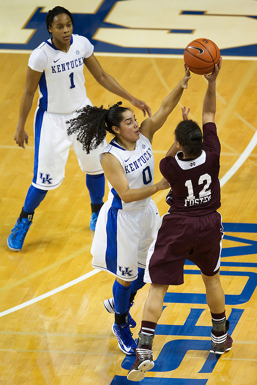 UK guard Jennifer O'Neill, center, gets the hand on a ball thrown by Mississippi State guard Candace Foster in the first half. The University of Kentucky Women hosted Mississippi State University Thursday, Jan. 17, 2013 at Memorial Coliseum in Lexington. Photo by Jonathan Palmer