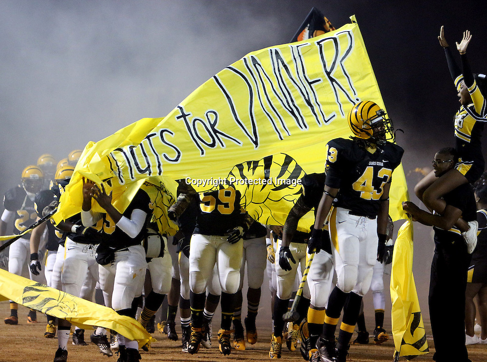 Members of the James Kenan High School Football team enter the field before their game against Princeton. (Jason A. Frizzelle)
