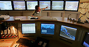 St. Lawrence, nws, lynn, 28.-Keith Ellis, who is in traffic training, is at the controls at the Eisenhower lock outside of Messina New York Monday August 8, 2005.  Ellis looks out the window as the Pinglen heads into the lock.  The monitors show the locations of ships in the seaway system.
