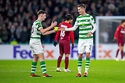 Mikael Lustig (#23) of Celtic FC gives Kieran Tierney (#63) of Celtic FC the captains armband after he had to go off injured during the UEFA Europa League Group B match between Celtic FC and RB Salzburg at Celtic Park, Glasgow, Scotland on 13 December 2018.
