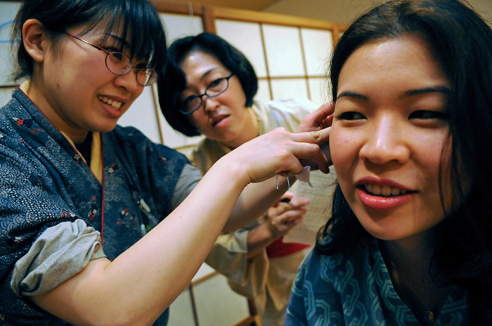 At Oedo Onsen.Ning Chao trying an ear acupuncture treatment
