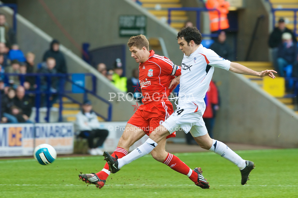 BOLTON, ENGLAND - Sunday, March 2, 2008: Liverpool's captain Steven Gerrard MBE and Bolton Wanderers' Joey O'Brien during the Premiership match at the Reebok Stadium. (Photo by David Rawcliffe/Propaganda)