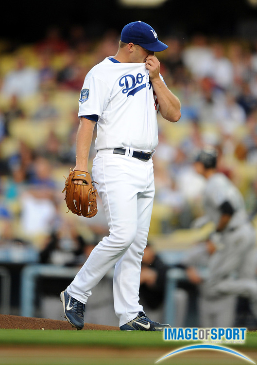Jul 11, 2008; Los Angeles, CA, USA; Los Angeles Dodgers starter Eric Stults (50) reacts after surrendering a home run in the first inning to Florida Marlins right fielder Jeremy Hermida (27) not pictured in the first inning at Dodger Stadium.