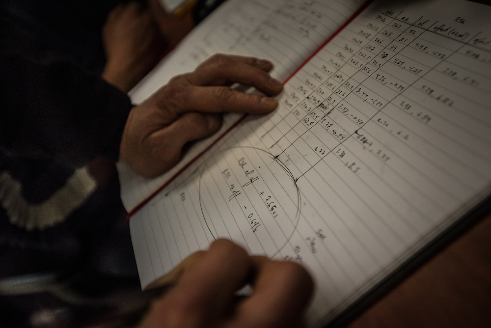 PICO DE ORIZABA NATIONAL PARK, PUEBLA, MEXICO - MARCH 27, 2015: Astronomer Sheperd Doeleman of MIT makes notes in his notebook while monitoring the data being received inside the control room of the Large Millimeter Telescope after successfully connecting the LMT to several other telescopes around the world to make one large telescope called the Event Horizon Telescope, as large as the earth that the LMT team believes has the capacity to make the first image of the black hole.   CREDIT: Meridith Kohut for The New York Times