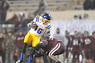 Oxford High's Zach Cousar (16) is tackled by Picayune's Daveon Greene in the MHSAA Class 5A championship game at Mississippi Veterans Memorial Stadium in Jackson, Miss. on Saturday, December 7, 2013. Picayune rallied to win 42-35.