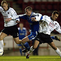 Clyde v St Johnstone..  07.12.02<br />Chris Hay is brought down by John Fraser and Simon Mensing<br /><br />Pic by Graeme Hart<br />Copyright Perthshire Picture Agency<br />Tel: 01738 623350 / 07990 594431