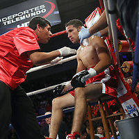 Jorge Pazos rests in his corner during a fight against Orlando Cruz at the Kissimmee Civic Center in Kissimmee, Florida, on Friday, October 19, 2012.  (AP Photo/Alex Menendez)