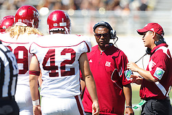 September 24, 2011; San Jose, CA, USA;  New Mexico State Aggies head coach DeWayne Walker (center) talks to his team before the game against the San Jose State Spartans at Spartan Stadium. San Jose State defeated New Mexico State 34-24.