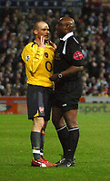 Photo: Ed Godden.<br /> Portsmouth v Arsenal. The Barclays Premiership. 12/04/2006. Freddie Ljungberg explains his actions to the ref U. Rennie.