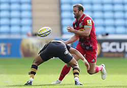 Harlequins Jamie Roberts is tackled by Wasps Marcus Watson during the Aviva Premiership match at the Ricoh Arena, Coventry.
