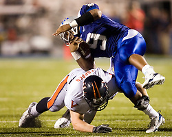 "Virginia linebacker Jon Copper (54) stops Middle Tennessee State quarterback Dwight Dasher (9)..The Virginia Cavaliers football team defeated Middle Tennessee State Blue Raiders 23-21 at Johnny ""Red"" Floyd Stadium  in Murfreesboro, TN on October 6, 2007."