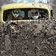 Ian Stewart/Yukon News<br /> Classic truck meets muddy trench.