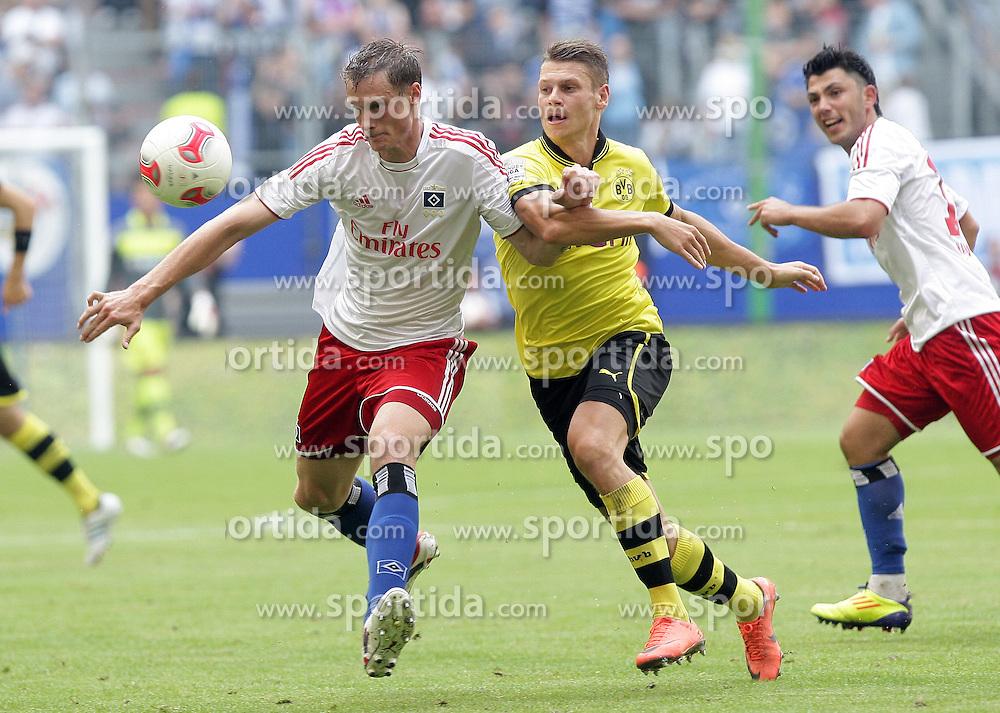 Football: Germany, Liga Total Cup, Hamburger SV - Borussia Dortmund, Hamburg, 04.08.2012.Marcell JANSEN (HSV, l.) und Lukasz PISZCZEK (BVB) .©Êpixathlon