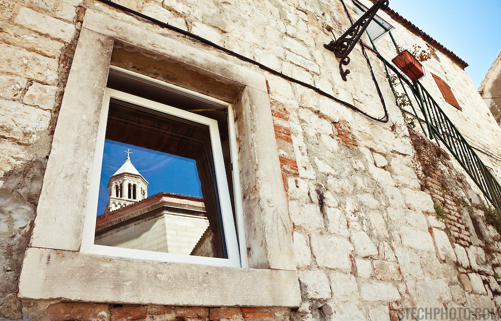 A window reflection of the Diocletian mausoleum and bell tower of the Cathedral of St. Duje (St. Doimus) in Split, Croatia.<br /> <br /> + ART PRINTS +<br /> To order prints or cards of this image, visit:<br /> http://greg-stechishin.artistwebsites.com/featured/st-duje-greg-stechishin.html