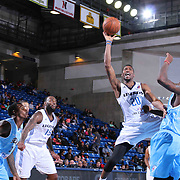 Texas Legends Forward Eric Griffin (20) drives towards the basket as Delaware 87ers Forward Victor Rudd (23) defends in the second half of a NBA D-league regular season basketball game between the Delaware 87ers and the Texas Legends (Dallas Mavericks) Sunday, Jan. 25, 2015 at The Bob Carpenter Sports Convocation Center in Newark, DEL