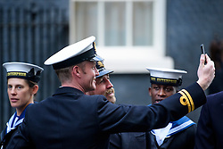 © Licensed to London News Pictures. 14/12/2016. London, UK. Members of Royal Navy pose for a selfie outside 10 Downing Street in London after meeting with British prime minister Theresa May at a reception for a Military awards. Photo credit: Ben Cawthra/LNP