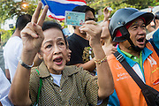 "01 FEBRUARY 2014 - BANGKOK, THAILAND: Thai voters try to get past police lines to vote in the Din Daeng area of Bangkok. Thais went to the polls in a ""snap election"" Sunday called in December after Prime Minister Yingluck Shinawatra dissolved the parliament in the face of large anti-government protests in Bangkok. The anti-government opposition, led by the People's Democratic Reform Committee (PDRC), called for a boycott of the election and threatened to disrupt voting. Many polling places in Bangkok were closed by protestors who blocked access to the polls or distribution of ballots. The result of the election are likely to be contested in the Thai Constitutional Court and may be invalidated because there won't be quorum in the Thai parliament.    PHOTO BY JACK KURTZ"