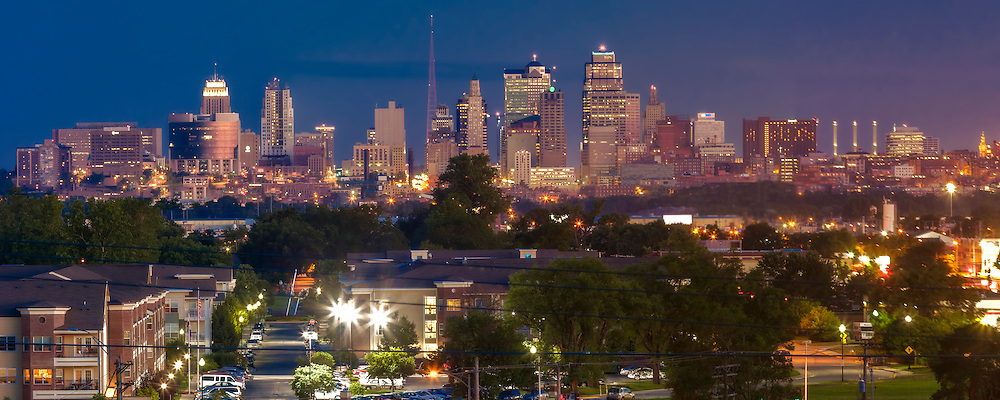 Panorama photo of downtown Kansas City, Missouri skyline at dusk, taken from Waterworks Park with view toward south.