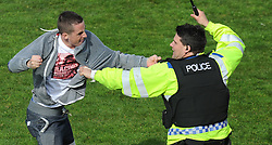 Police try to gain control of the fans. - Photo mandatory by-line: Alex James/JMP - Mobile: 07966 386802 03/05/2014 - SPORT - FOOTBALL - Bristol - Memorial Stadium - Bristol Rovers v Mansfield - Sky Bet League Two