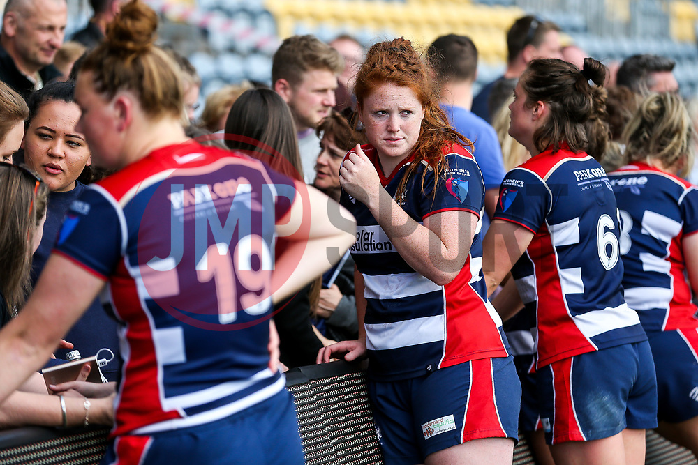 Kayleigh Armstrong and the Bristol Ladies players are consoled by their friends and families in the stands after losing in the Play Off Final having finished the regular season top of the league - Rogan Thomson/JMP - 23/04/2017 - RUGBY UNION - Sixways Stadium - Worcester, England - Bristol Ladies Rugby v Aylesford Bulls - Women's Premiership Final.