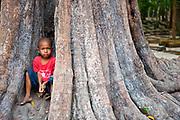 Young child, TA PROHM, Angkor Wat, Siem Reap, Cambodia