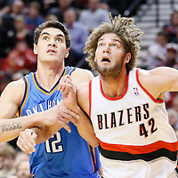 04 December 2013: Oklahoma City Thunder center Steven Adams (12) vies for the rebound with Portland Trail Blazers center Robin Lopez (42) during the Portland Trail Blazers 111-104 victory over the Oklahoma City Thunder at the Moda Center, Portland, Oregon, USA.