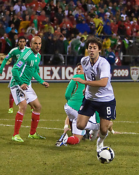 United States forward Clint Dempsey (8) chases a loose ball in front of Mexico forward Carlos Ochoa (11).  The United States men's soccer team defeated the Mexican national team 2-0 in CONCACAF final group qualifying for the 2010 World Cup at Columbus Crew Stadium in Columbus, Ohio on February 11, 2009.