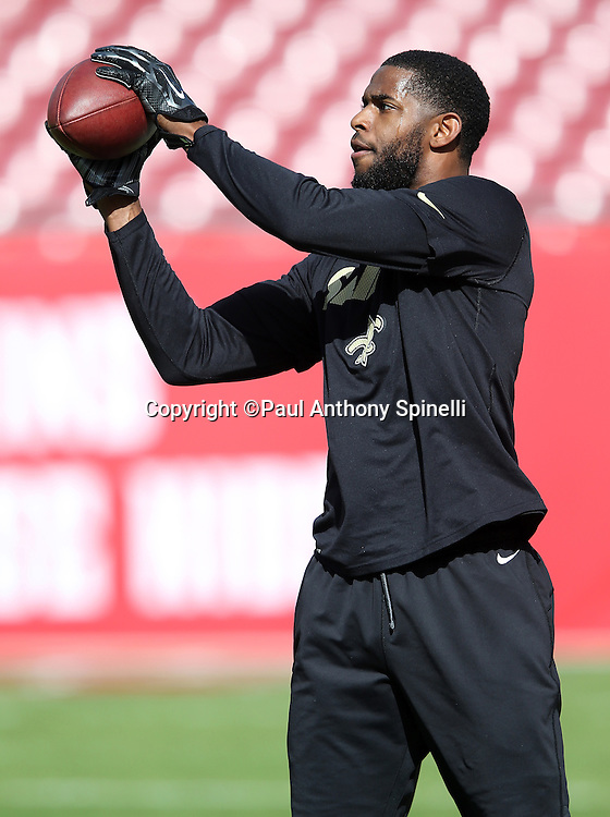 New Orleans Saints wide receiver Marques Colston (12) catches a pass while warming up before the 2015 week 14 regular season NFL football game against the Tampa Bay Buccaneers on Sunday, Dec. 13, 2015 in Tampa, Fla. The Saints won the game 24-17. (©Paul Anthony Spinelli)