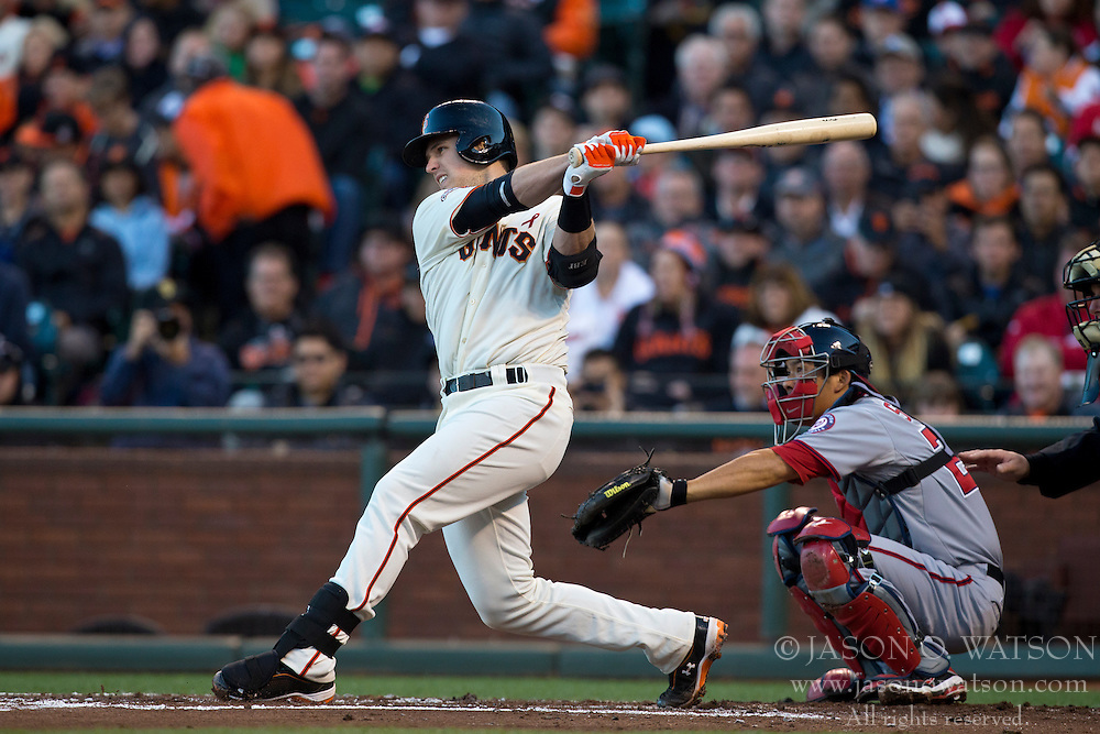 SAN FRANCISCO, CA - MAY 21: Buster Posey #28 of the San Francisco Giants hits a single against the Washington Nationals during the first inning at AT&T Park on May 21, 2013 in San Francisco, California. The San Francisco Giants defeated the Washington Nationals 4-2 in 10 innings. (Photo by Jason O. Watson/Getty Images) *** Local Caption *** Buster Posey