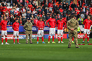Charlton Athletic observe a period of silence for Remembrance ahead of kick-off during the EFL Sky Bet Championship match between Charlton Athletic and Preston North End at The Valley, London, England on 3 November 2019.